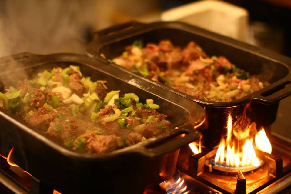 The aroma of your meal entice your tastebuds whilst you enjoy the show around the campfire
